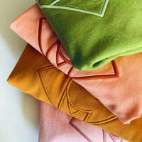 NCM-Baehr-Sweatshirt-mit-Logo-Stickerei-Farben-ocker-rosé-grün-pfirsich